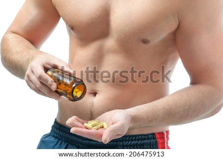 Athletic young man using bodybuilding dietary supplements. Sports nutrition - stock photo