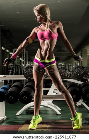 Athletic young woman doing a fitness workout  - stock photo
