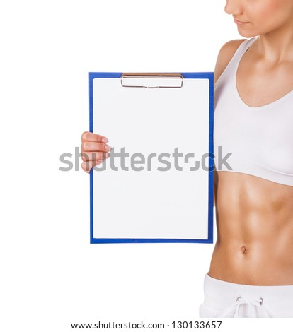 Athletic young woman showing a blank clipboard sign isolated on white background - stock photo