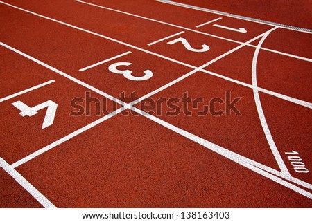 Athletics Start track lanes 1 2 3 of a red running racing track - stock photo
