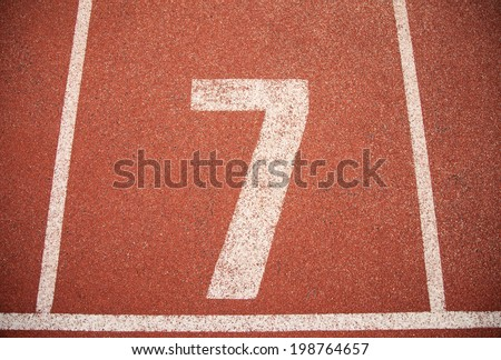 Athletics Track Lane Number seven 7 - stock photo