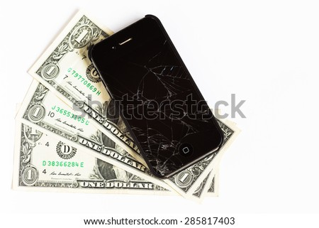 ATLANTA, GA - JUNE 1, 2015: Apple iPhone cellphone laying on dollars bills. Apple Inc. is an American multinational technology company. - stock photo