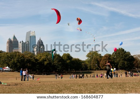 ATLANTA, GA - OCTOBER 26:  Composite shows multiple kites flying over Piedmont Park combined into one image, as people take part in the World Kite Festival on October 26, 2013 in Atlanta, GA.  - stock photo