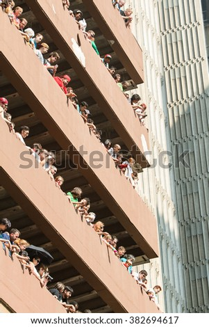 ATLANTA, GA - SEPTEMBER 5:  Spectators fill multiple levels of a parking deck to watch the annual Dragon Con Parade below on Peachtree Street on September 5, 2015 in Atlanta, GA.  - stock photo