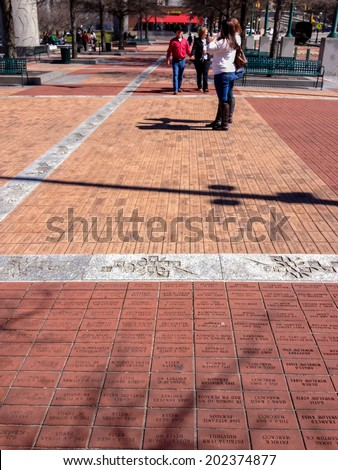 ATLANTA, GA, USA, MARCH 5, 2014 - Bricks engraved with short messages of donors at Centennial Olympic Park laid as pavers on March 5, 2014 in Atlanta, GA. 800000 such bricks are used in this sidewalk  - stock photo