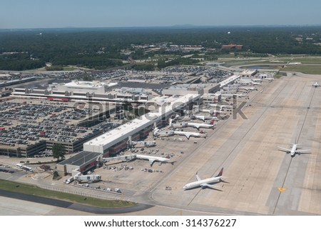 ATLANTA, GEORGIA-AUGUST 25, 2015: Aerial view of Hartsfield-Jackson Atlanta International Airport. The Atlanta airport serves 89 million passengers a year, it is the world's busiest airport. - stock photo