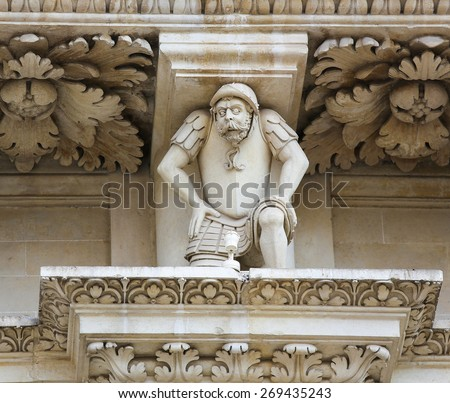 Atlante of a Turkish prisoner of war at the Battle of Lepanto (1571) at the Basilica of Santa Croce or Church of the Holy Cross, a baroque church in Lecce, Apulia, Southern Italy.  - stock photo