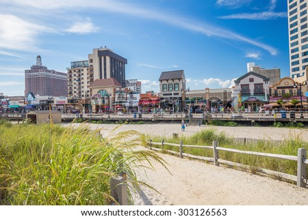 ATLANTIC CITY,  NEW JERSEY - August 3: The boardwalk and Casinos on August 3, 2015 in Atlantic City, New Jersey. Gambling was legalized in the city in 1976 and led to a resurgence. - stock photo