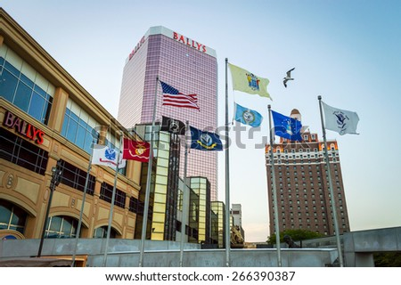 ATLANTIC CITY NEW JERSEY - SEPTEMBER 2: Flags waving by Bally's casino on September 2 2014 in Atlantic City New Jersey. - stock photo