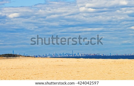 Atlantic Ocean shore at Sandy Hook with a view on NYC. Sandy Hook is in New Jersey, USA. - stock photo