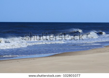 Atlantic ocean waves on the beach at Montauk point, eastern tip of Long Island, New York, Suffolk County - stock photo