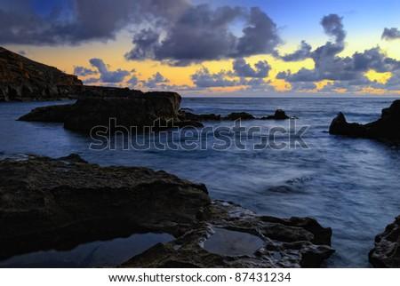 Atlantic sunset over Canary  Island, Lanzarote, El Golfo bay - stock photo