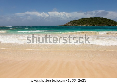 Atlantic Waves on Beautiful Golden Sandy Beach at Half Moon Bay Antigua - stock photo