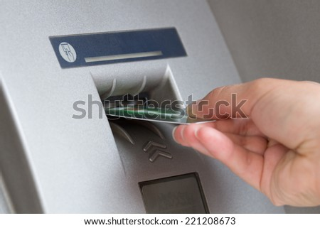 ATM cash withdrawal. Shallow DoF. - stock photo