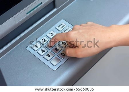 ATM - entering pin - stock photo