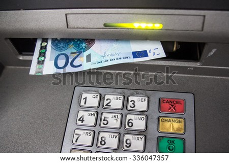 ATM machine withdrawing money - stock photo
