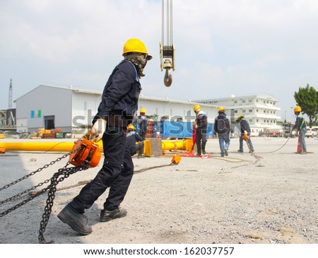 Atmosphere in the construction and installation of crane. - stock photo