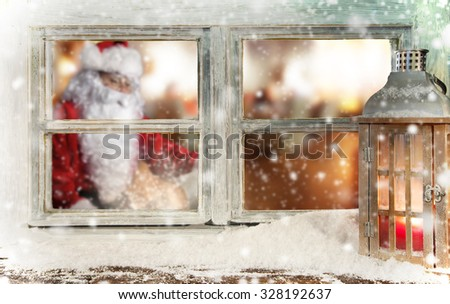 Atmospheric Christmas window sill decoration with Santa Claus - stock photo