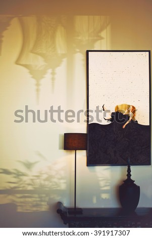 Atmospheric living room interior. Shadows on the wall, fashion woman portrait - stock photo