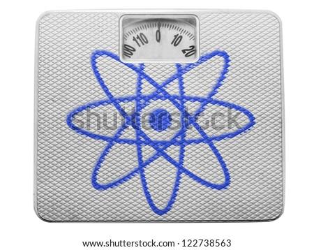 Atom symbol painted on painted on balance - stock photo