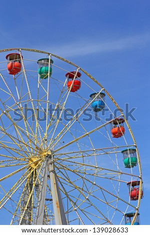 Atraktsion colorful ferris wheel against the blue sky - stock photo