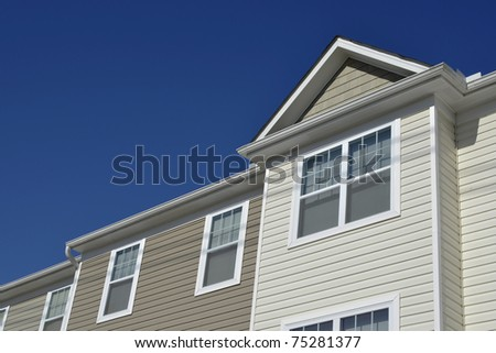 Attached townhomes roof line - stock photo