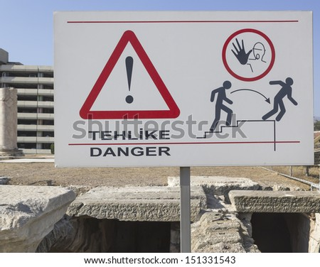 attention to the danger of falling: if you are not careful you will fall while touring the agora-smyrna - stock photo