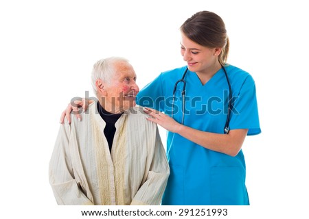 Attentive and caring young nurse supporting a sick elderly woman. - stock photo