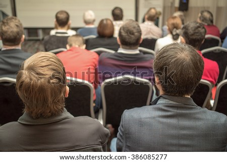 Attentive listeners at the business conference hall - stock photo