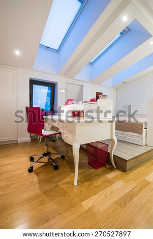 Attic converted into a student,teenage room  - stock photo