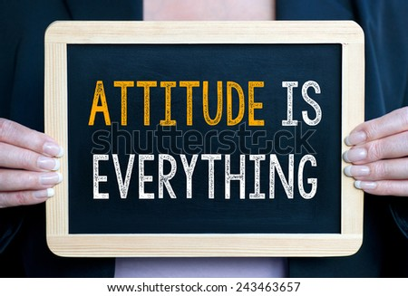 Attitude is everything - Businesswoman with chalkboard - stock photo