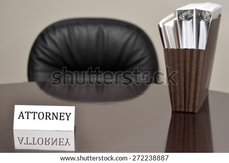 Attorney business card on desk with files and chair - stock photo