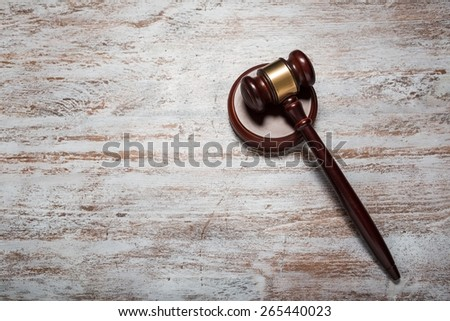 Attorney. Judge gavel on the brown wooden table with space for text - stock photo