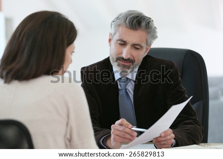 Attorney meeting client in office - stock photo