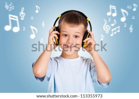attracive kid is listening music with headphones - stock photo
