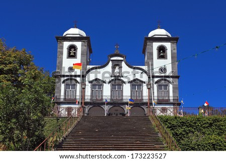 Attractions Portuguese island of Madeira. The magnificent white church of Nossa Senhora do Monte. - stock photo
