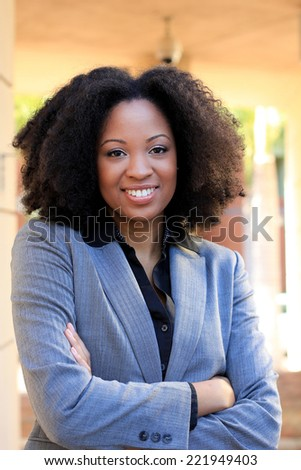 Attractive African American Business Professional Business Woman Confident Arms Crossed Happy and Smiling - stock photo