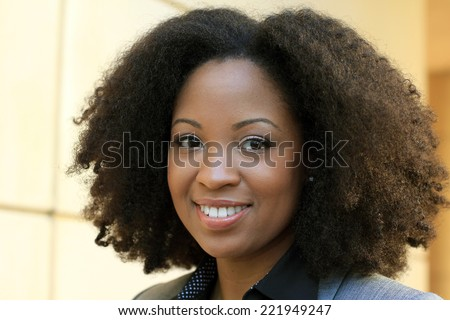 Attractive African American Business Professional Business Woman Happy and Smiling - stock photo