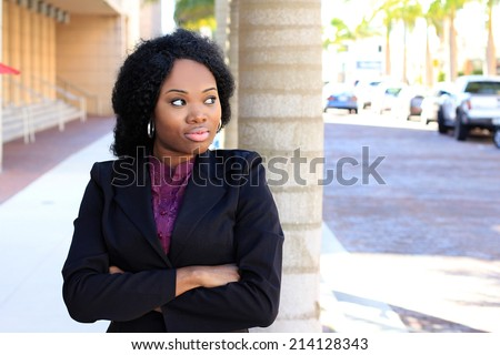 Attractive African American Business Professional Looking To Side Arms Crossed Wearing Suit - stock photo