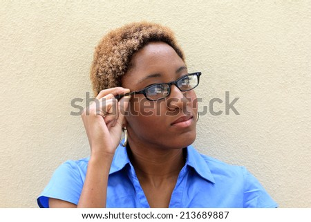 Attractive African American Business Professional Student Wearing a Blue Shirt Serious Expression Wearing Glasses - stock photo