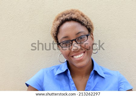 Attractive African American Business Woman Smiling and Looking At the Camera Black and Blonde Hair Copy Space - stock photo