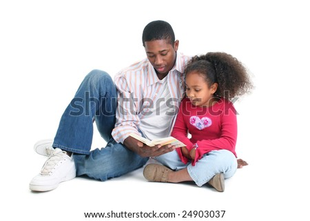 Attractive African American man and child reading together. - stock photo