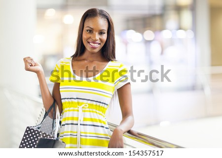 attractive african american woman in shopping mall - stock photo