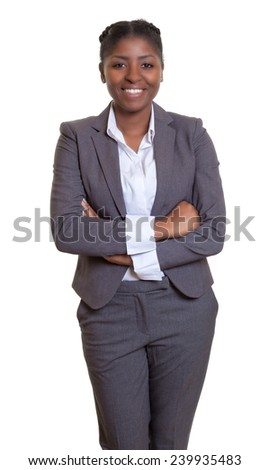 Attractive african businesswoman with crossed arms - stock photo