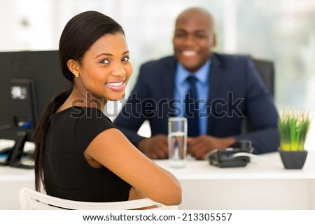 attractive african office worker looking back - stock photo