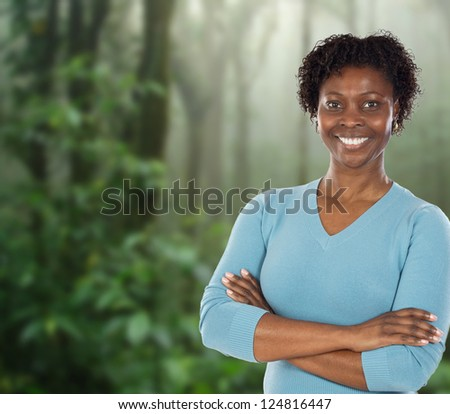 Attractive African woman in a tropical rainforest - stock photo