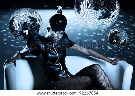 Attractive african woman with disco balls - stock photo