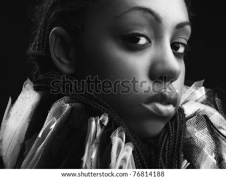 Attractive afro-american beauty in a black-white theatrical jabot. Close-up Portrait. - stock photo