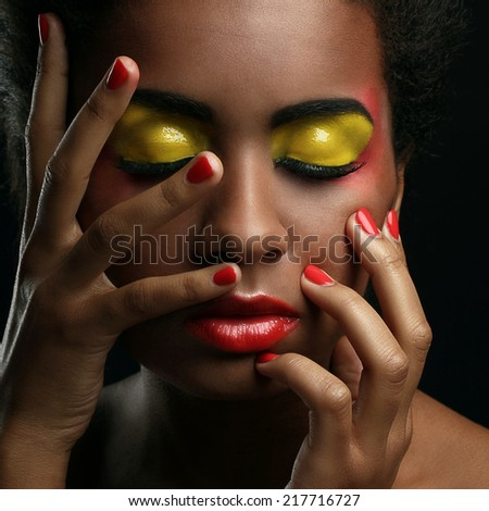 Attractive afro-american woman with beautiful make-up - stock photo