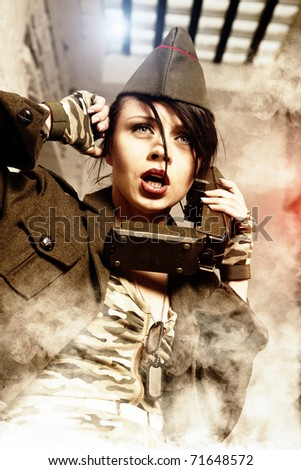 Attractive and sexy army girl - stock photo